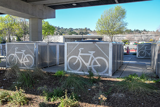 Image of about 5 large metal bike storage structures.