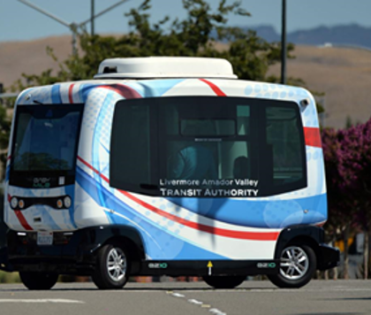 Image of a small autonomous shuttle that may be used to transport people in the future.