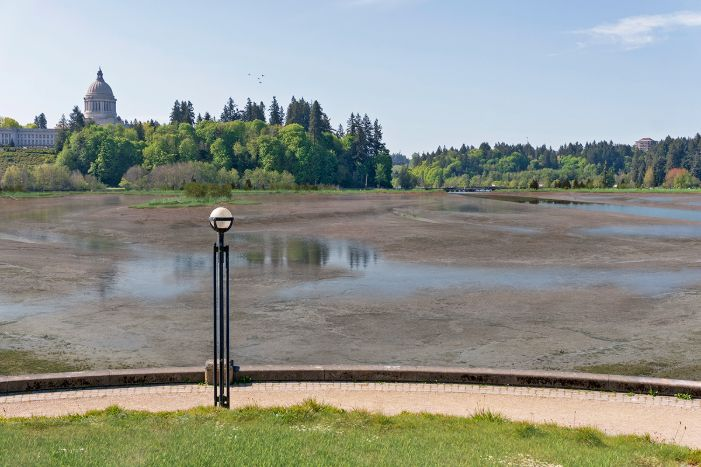 A visual simulation of the Estuary Alternative, looking south from the Eastern Washington Butte in Heritage Park. The visual simulation was generated to represent the potential views across the North Basin, toward the Capitol Building. There is very little water in the North Basin and the predominant habitat showing is tideflats; there is some vegetated habitat along the shorelines.