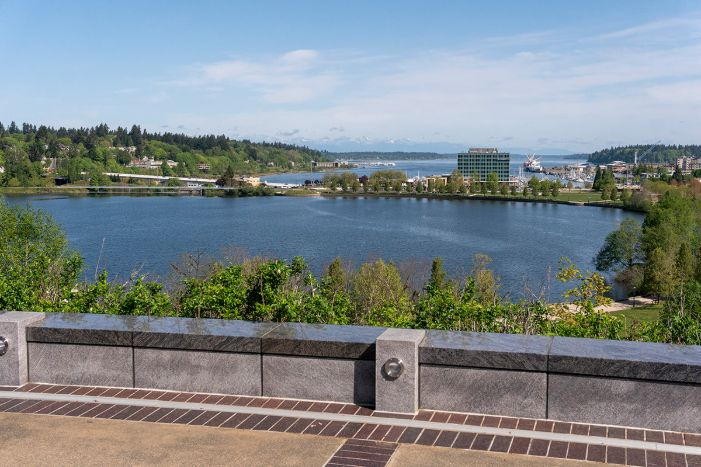 A visual simulation of the Managed Lake, looking north toward the North Basin and Budd Inlet. The visual simulation was generated to represent the potential viewshed from a North Overlook on the Washington State Capitol Campus. The North Basin is full of water and a new 5th Avenue Pedestrian bridge can be seen in the distance, near 5th Avenue.