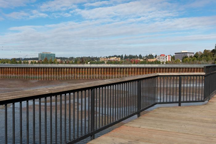 A visual simulation of the Hybrid Alternative, looking east from Marathon Park. The visual simulation was generated to represent the potential views from the North Basin, toward the reflecting pool. The sheet pile barrier wall is the most significant feature in the visual landscape, and there are tidal flats. Water marks along the sheet pile barrier wall are apparent.